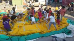 Children helping to pack the bouncy castle in Balat, Istanbul