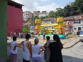 Neighbours watching the bouncy castle in Balat, Istanbul
