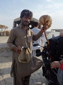 Buying gas near Dalbadin, Pakistan