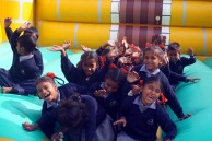 Children on the bouncy castle in Dehra Dun, India