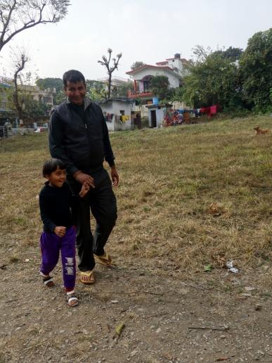 Neighbor kid full of anticipation in Dehra Dun, India