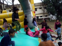 Ukrainian, Indian and Tibetian girls on the bouncy castle in Dehra Dun, India