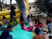 Ukrainian, Indian and Tibetian girls on the bouncy castle in Dehra Dun, India
