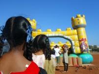 Children waiting in line to jump in Mapusa, Goa