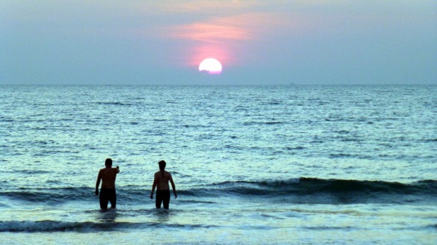 Sunset swim after a bouncy day in Goa, India