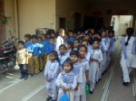 Children waiting for the bouncy castle at the Miracle school Lahore, Pakistan