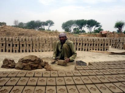 Worker in the brick kiln near Lahore, Pakistan