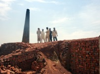 Curious workers in the brick kiln near Lahore, Pakistan