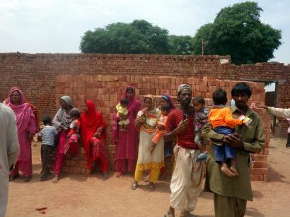 Parents in the brick kiln near Lahore, Pakistan